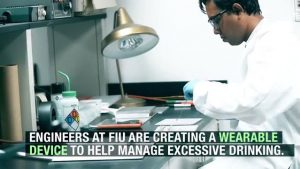 FIU student researcher working on weareable device