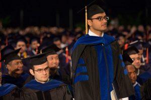 Graduate student in ceremony standing