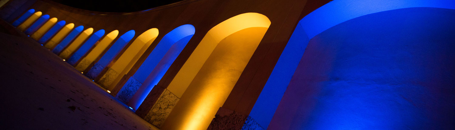 Campus main entrance_ blue and gold lights on arches