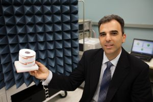 Dr. Georgakopolous holding Morphing Origami Multi-functional and Reconfigurable Antenna.